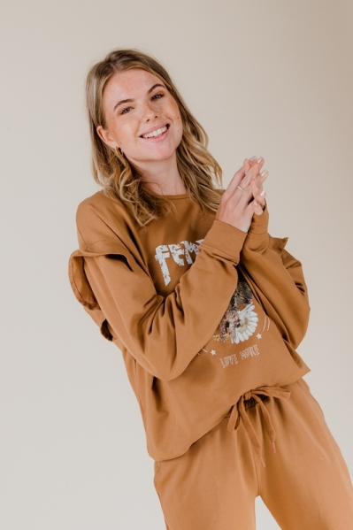 sweater with artwork and ruffle camel